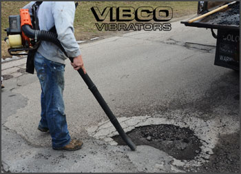 cleaning out a pothole