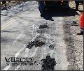 filling in a pothole with patch