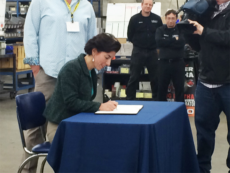 raimondo-comes-to-vibco-april-2015-lean-in-rhode-island--signing-1
